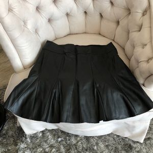 Black pleated pleather mini side zip